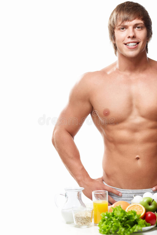Healthy food. Sports naked man with healthy food stock images