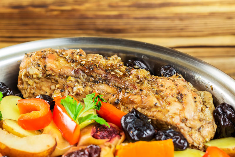 Healthy food, stewed pork meat with various colorful vegetables in pan, selective focus, space for text. Healthy food, stewed pork meat with various colorful royalty free stock photo