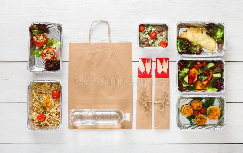 Healthy food take away in boxes, top view at wood. Healthy restaurant food background. Eating right concept. Fresh diet daily meals delivery. Fitness nutrition royalty free stock photo