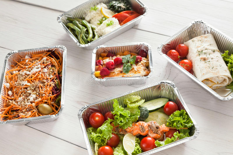 Healthy food take away, top view at wood background royalty free stock image