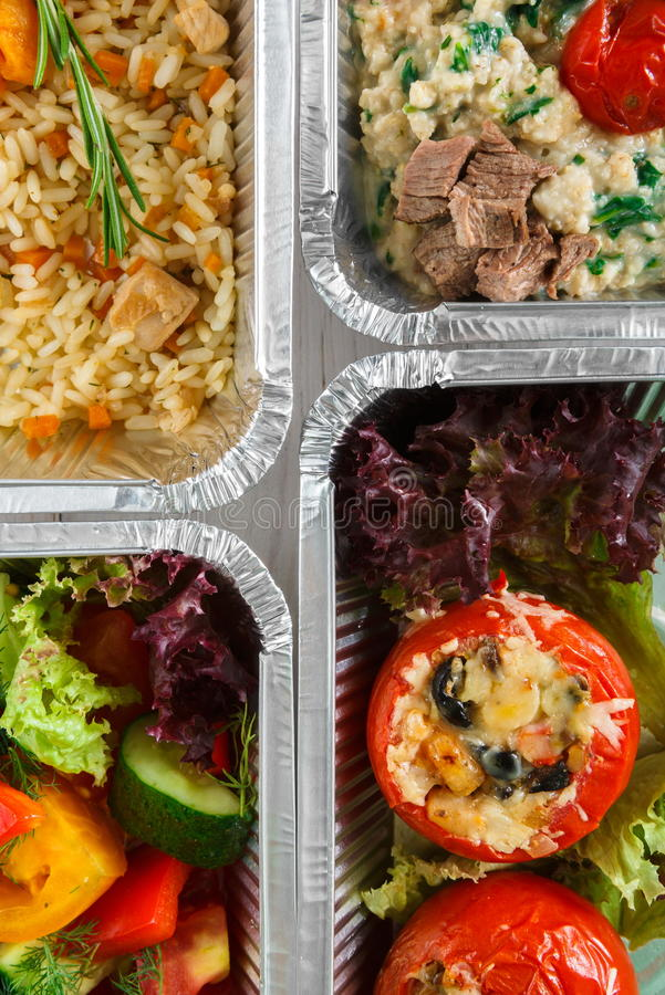 Healthy food take away, top view at wood background. Healthy food background. Take away of natural organic meals in foil boxes. Fitness nutrition, meat, fresh stock photography