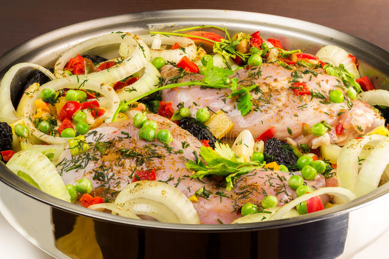 Healthy food, uncooked dietary rabbit meat with various vegetables in pan, close-up view stock image