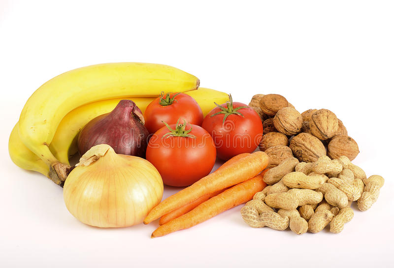 Healthy food, vegetables, fruit and nuts stock image