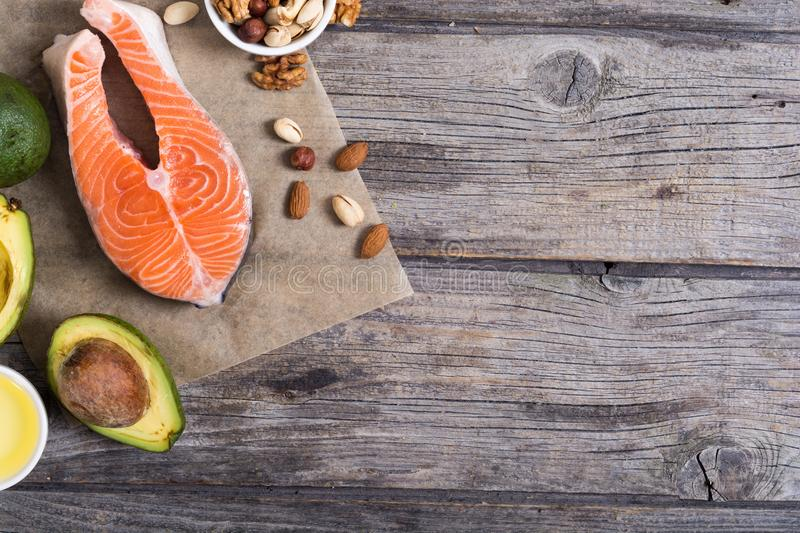 Healthy food vegetables , nuts and salmon royalty free stock photo