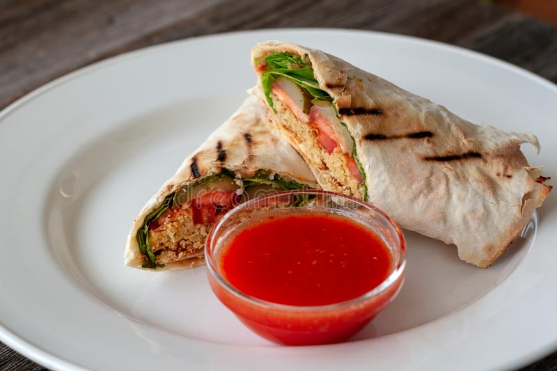 Healthy food. Vegetarian dish - the falafel wrap with hot sauce royalty free stock photo