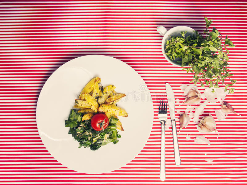 The healthy food - vegetarian meal with spinach, potatoes and he royalty free stock photos