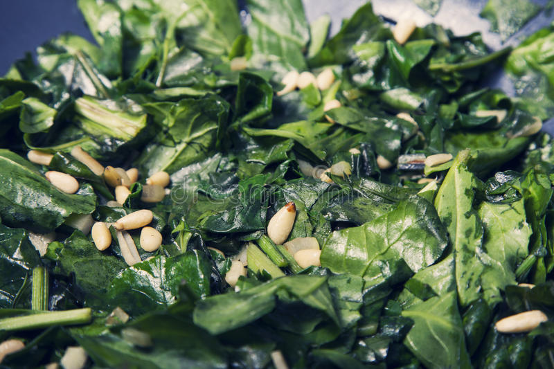 The healthy food - vegetarian meal with spinach, potatoes and he royalty free stock photography