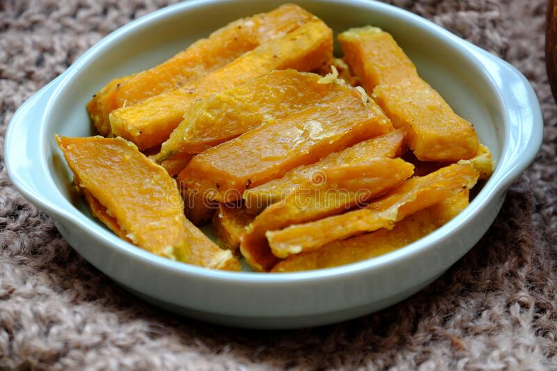 Healthy food for vegetarian, sliced of baked yellow squash, nutrition for vegan meal or non meat diet. High view plate of healthy food for vegetarian, sliced of stock image