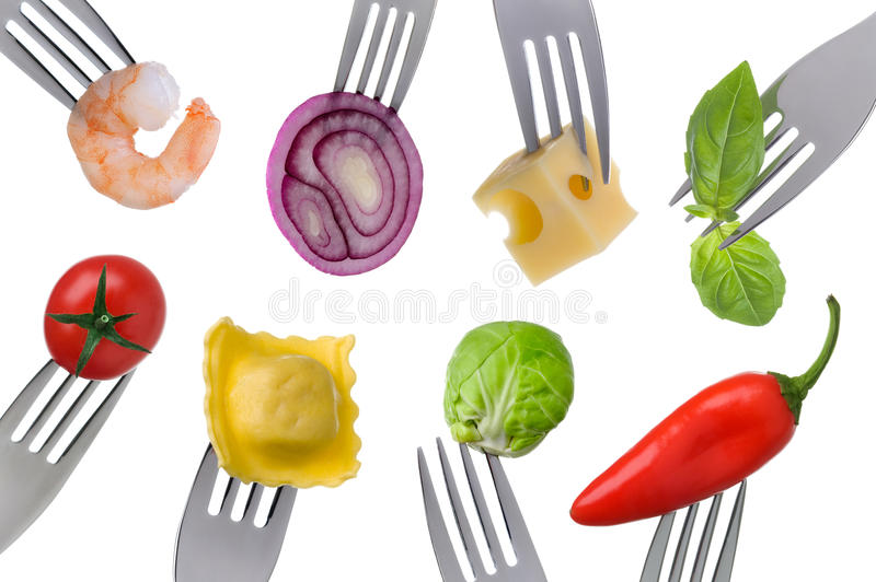 Healthy food on white. Variety of healthy food on forks isolated on a white background royalty free stock photo