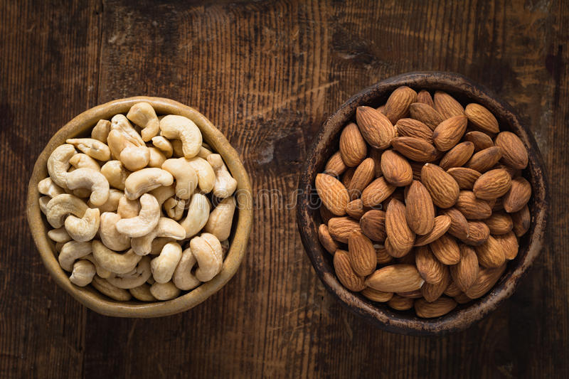 Image result for almonds and cashews on the wooden table