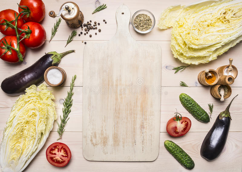 Healthy foods, cooking and vegetarian concept different vegetables and ingredients for the salad, lined around white cutting b stock photography