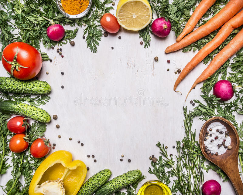 Healthy foods, cooking and vegetarian concept fresh carrots with cherry tomatoes, garlic, lemon radish, peppers, cucumbers, butter stock photography
