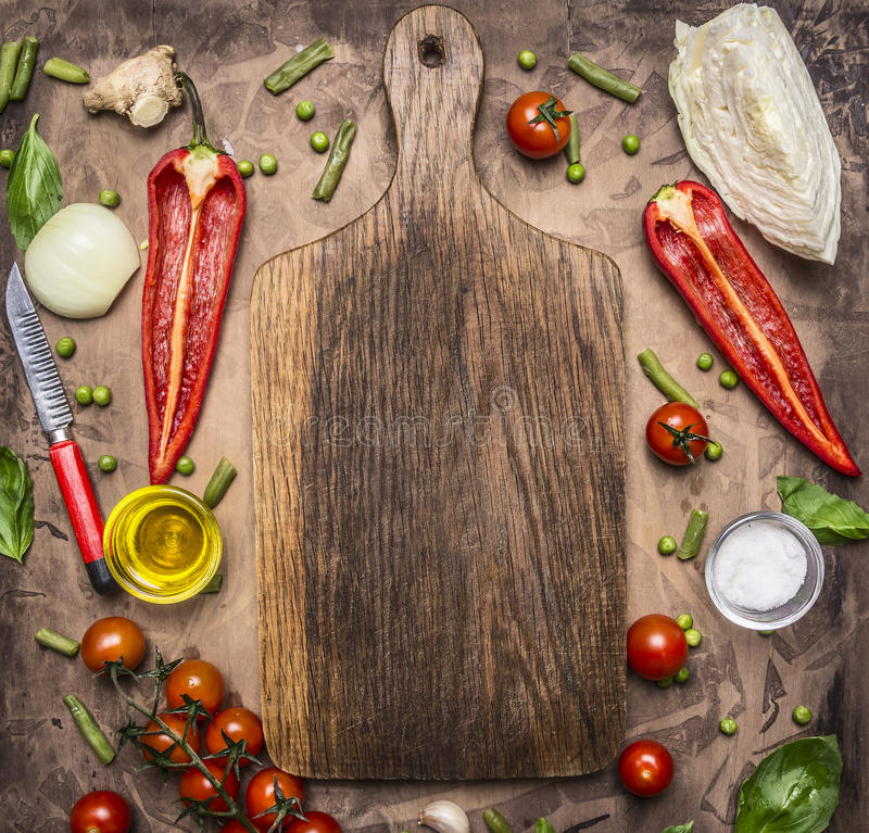 Healthy foods, cooking and vegetarian concept variety of vegetables and fruits are laid out around the cutting board, place for te stock image