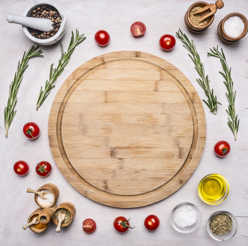 Healthy foods, cooking and vegetarian concept various vegetables, spices and herbs arranged around cutting board place for tex. Healthy foods, cooking and stock photography