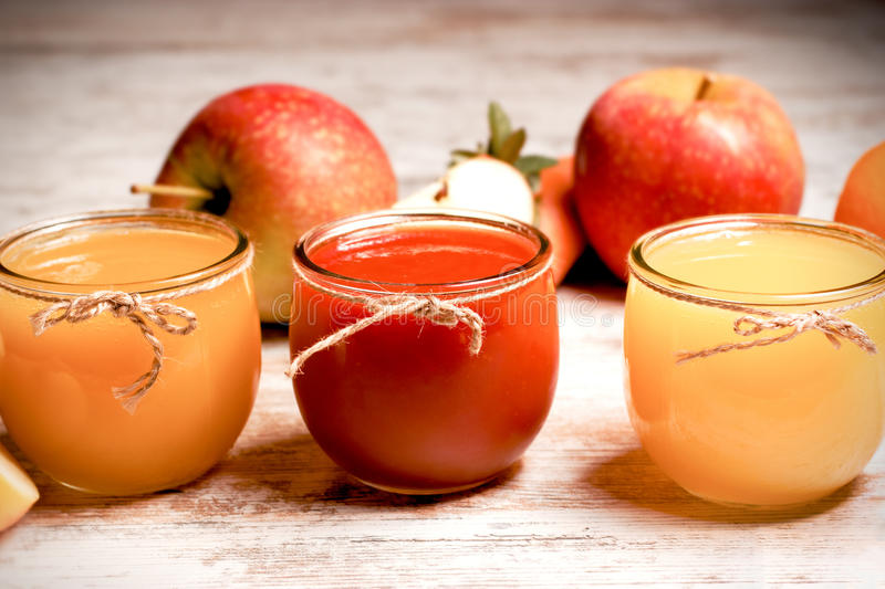 Healthy fresh fruit juice - freshly squeezed juices from organic fruits. Healthy fresh beverage drinks - fruit juices made with organic fruits royalty free stock photo