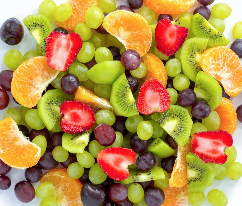 Healthy fresh fruit salad on white background. Top view.Fruit background,Closeup royalty free stock photo