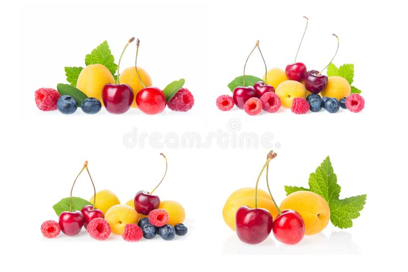 Healthy fresh fruits collage set group mix. Composition of ripe red sweet cherry with horns, raspberries, apricots and blueberries. With leaves isolated on royalty free stock photos