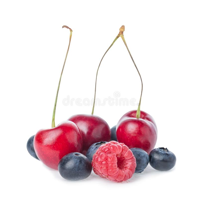 Healthy fresh fruits. Composition of ripe red sweet cherry with horns, raspberry and blueberries isolated on white background.  royalty free stock photo