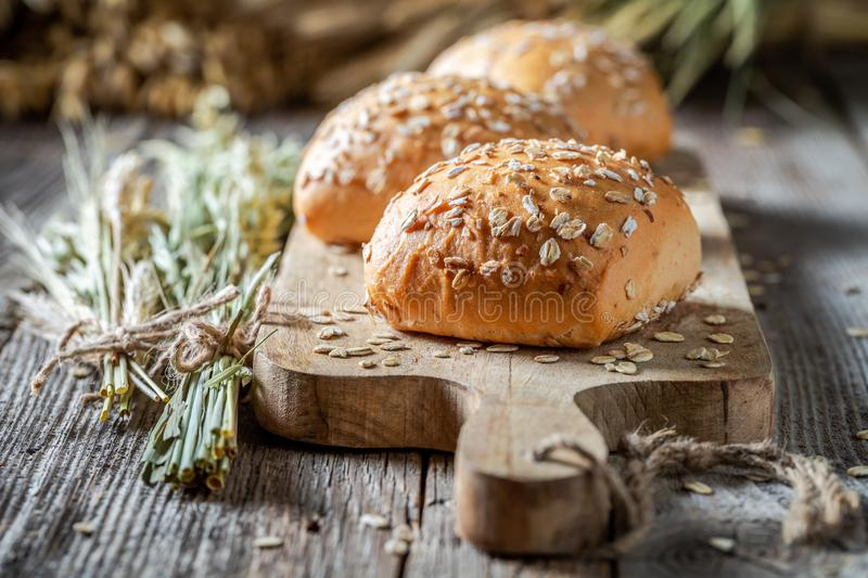 Healthy and fresh rolls with oat flakes stock photography