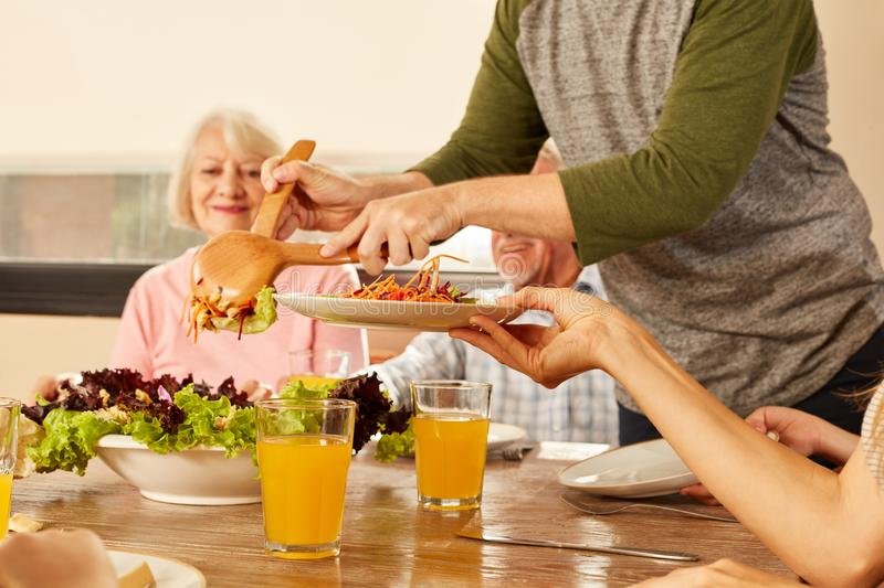 Healthy salad and orange juice on the table stock images