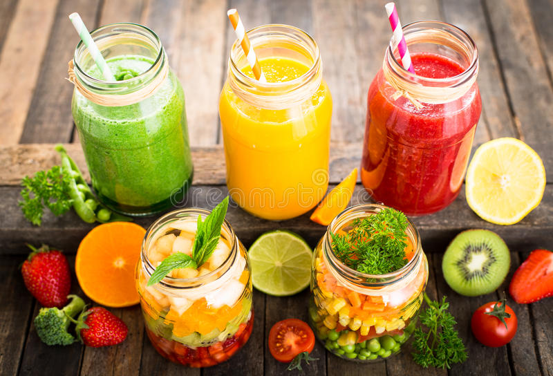 Healthy fruit and vegetable salad and smoothies stock photo