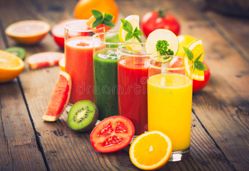 Healthy fruit and vegetable smoothies royalty free stock photography