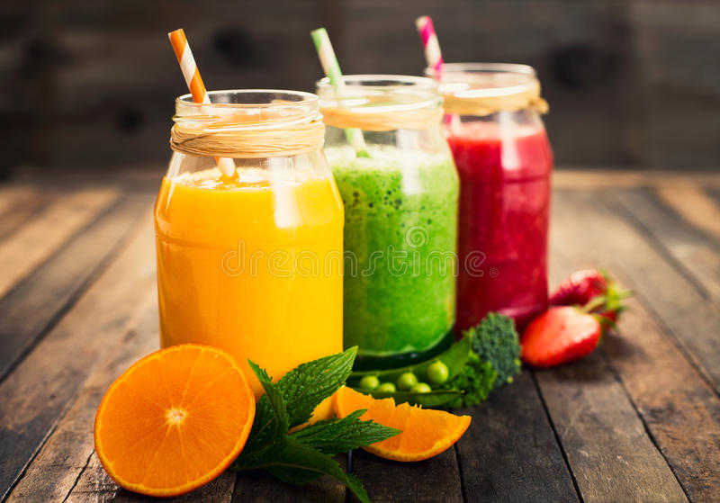 Healthy fruit and vegetable smoothies royalty free stock photo