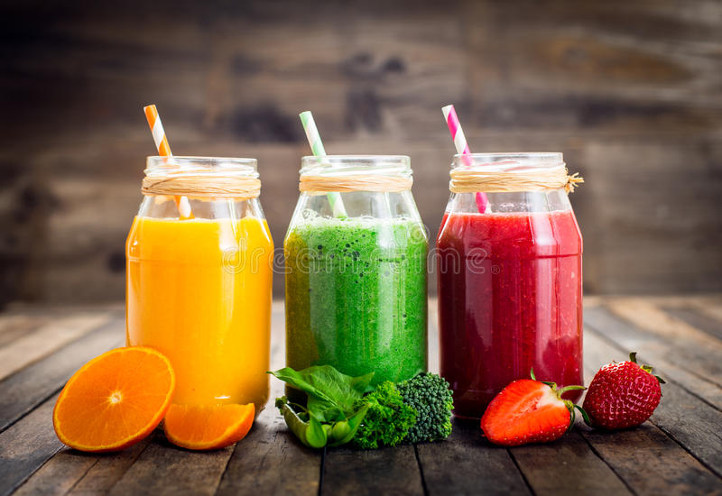 Healthy fruit and vegetable smoothies stock images