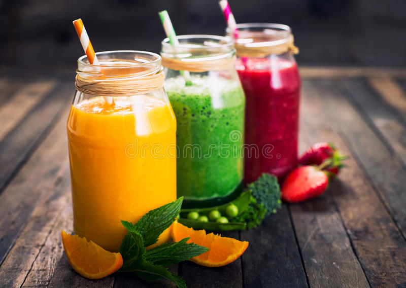 Healthy fruit and vegetable smoothies royalty free stock photos
