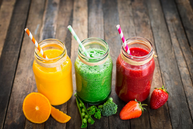 Healthy fruit and vegetable smoothies stock photography