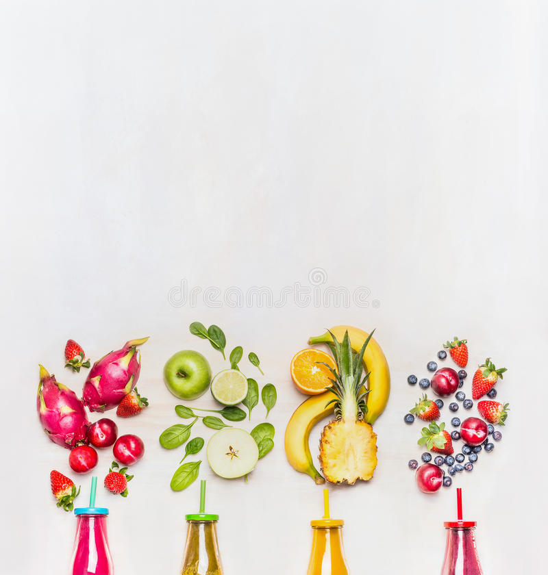 Healthy fruits smoothies with colorful ingredients on white wooden background, top view, place for text. Superfoods and healthy lifestyle or detox diet food stock photography