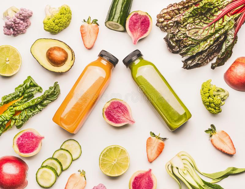 Healthy fruits and vegetables ingredients on white desk background, top view, flat lay, pattern. Healthy clean and detox stock photography