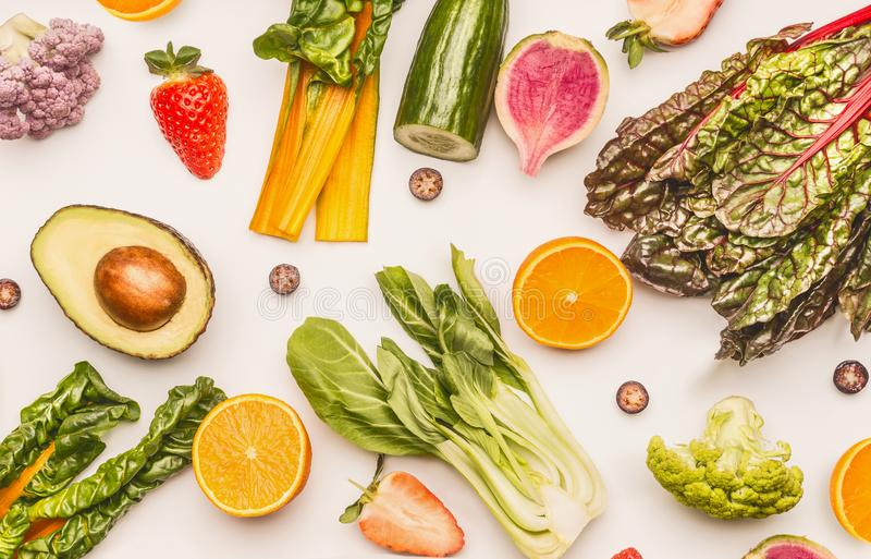 Healthy fruits and vegetables ingredients on white desk background, top view, flat lay, pattern. Healthy clean and detox stock photos