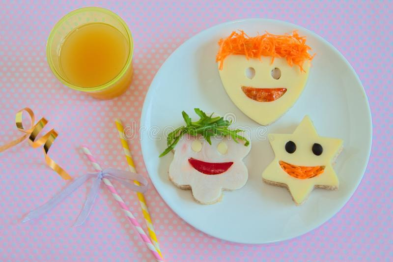Healthy and fun food for kids, funny faces sandwiches for party stock images