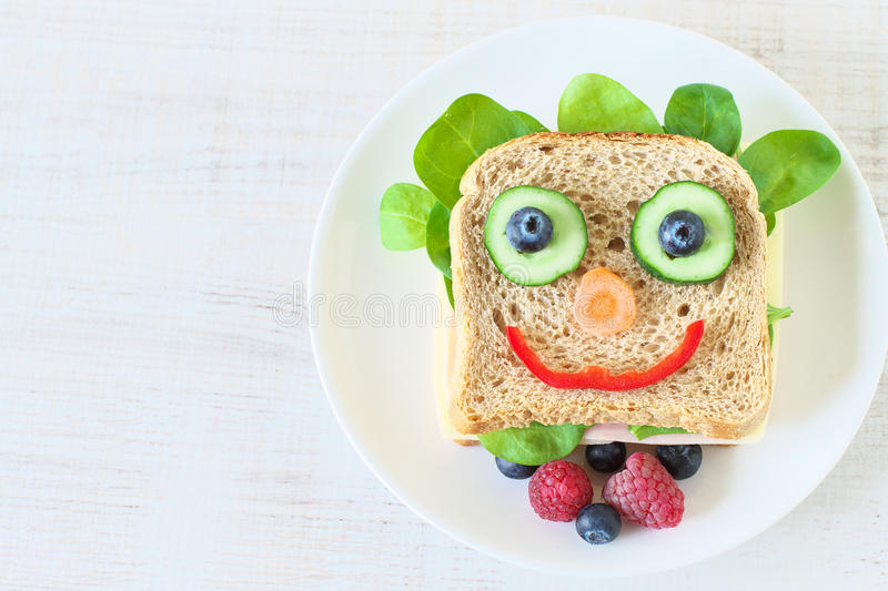 Healthy and fun food for kids. Happy and funny face sandwich stock images