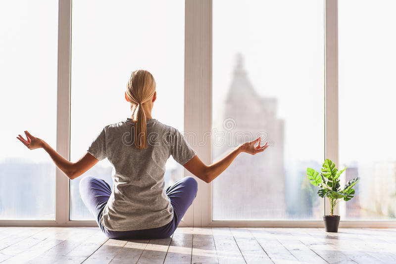 Healthy girl meditating with serenity stock image