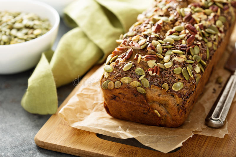 Healthy gluten free banana bread. With seeds and nuts royalty free stock photography
