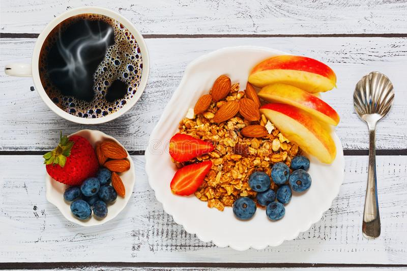 Healthy granola breakfast with fresh coffee stock photo