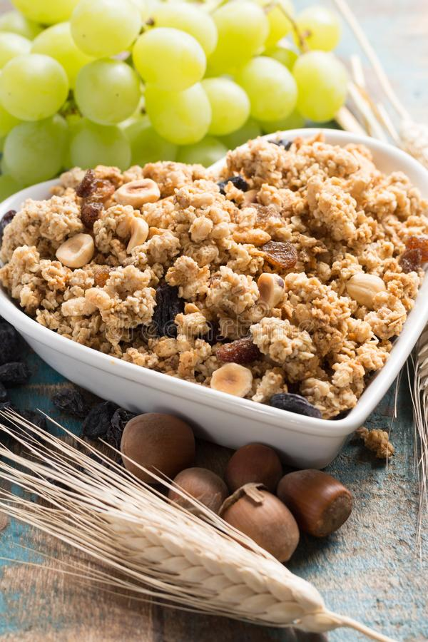 Healthy granola muesli breakfast with grape, nuts and wheat ears stock image