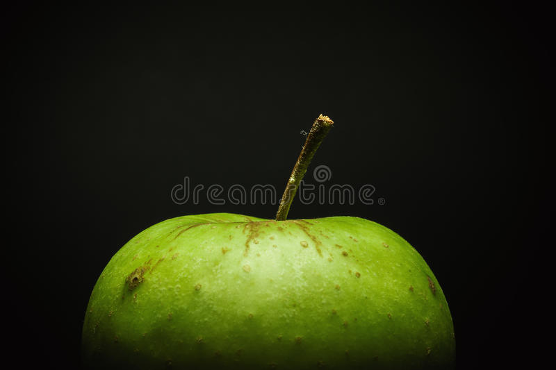Healthy Green Apple. Details of one green apple on dark background stock images