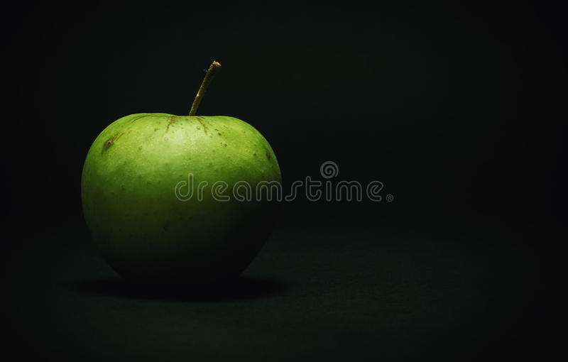 Healthy Green Apple. Details of one green apple on dark background stock image
