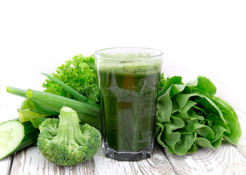 Healthy green juice. Healthy green vegetable juice on wooden table stock images