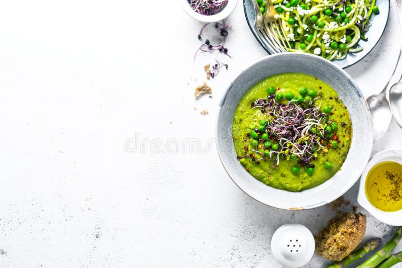 Healthy green pea soup and zucchini noodles royalty free stock photo