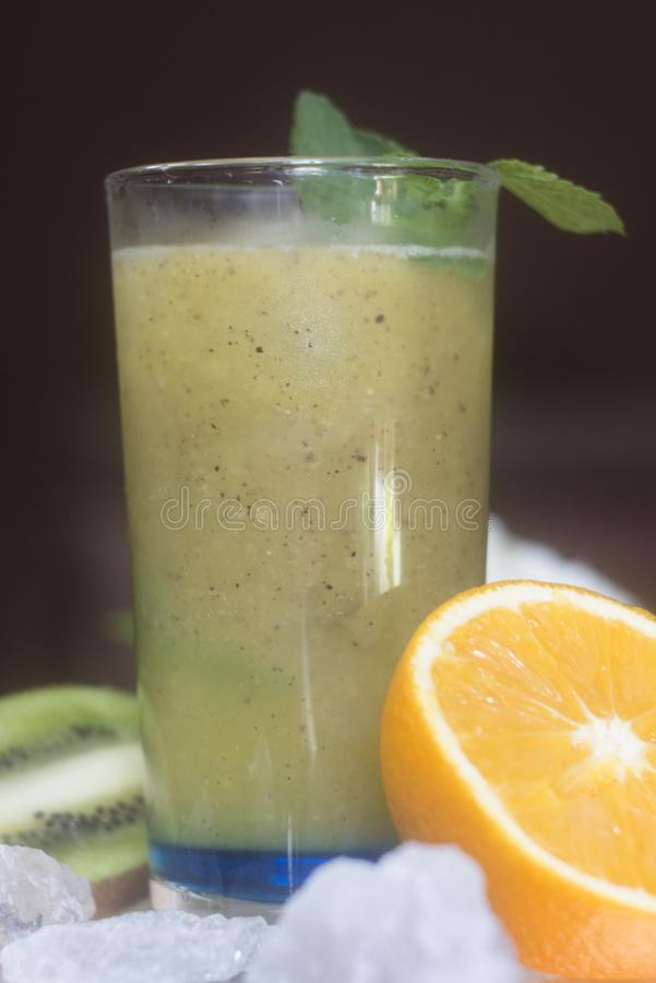 Healthy green smoothie with kiwi and oranges stock photos