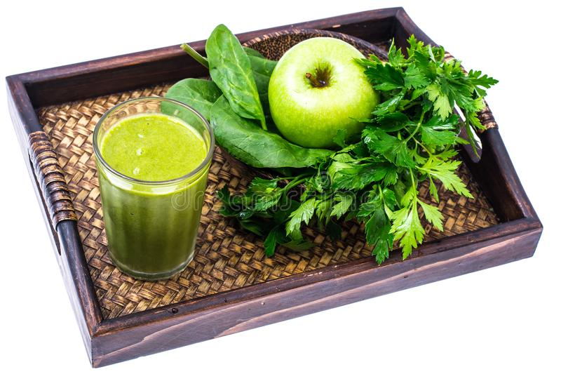 Healthy green smoothies of spinach, parsley and apple royalty free stock images