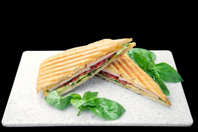 Healthy Grilled Basil mozzarella Caprese Panini Sandwich white Board isolated. Classic Italian fast food royalty free stock photography