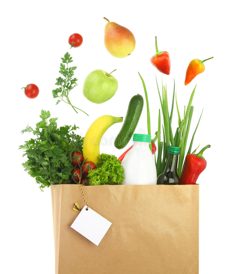 Healthy groceries in a paper bag royalty free stock photos