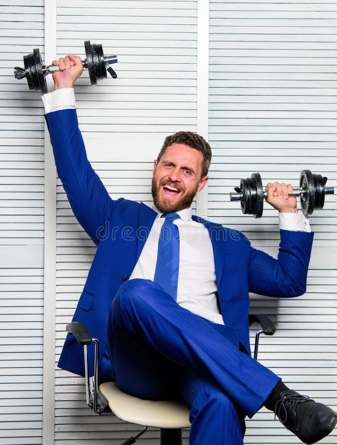 Healthy habits in office. Strong powerful business strategy. Man raise heavy dumbbells. Boss businessman manager raise. Hands with dumbbells. Sport healthy royalty free stock image