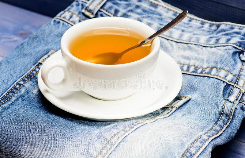 Healthy habits. Tea time concept. Cup mug hot water and bag of tea. Process tea brewing in ceramic mug. Herbal green or royalty free stock photos
