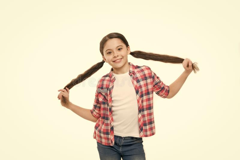 Healthy hair care habits. Kid happy smiling cheerful face with adorable hairstyle white background isolated. Strong hair royalty free stock images
